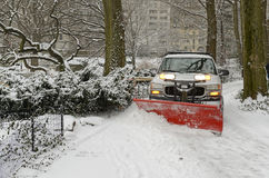 Truck snowplowing road after snowstorm Stock Photos