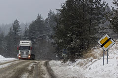 Truck on a snowy road in Slovakia Royalty Free Stock Photos
