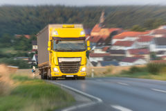 Truck speeding on a country road Royalty Free Stock Photo