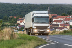 Truck speeding on a country road Royalty Free Stock Photography