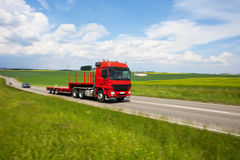 Truck Speeding on Country Road, Blurred Motion. Red Truck Speeding on Country Road, Blurred Motion Stock Photos