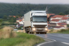 Truck speeding on a country road Royalty Free Stock Image