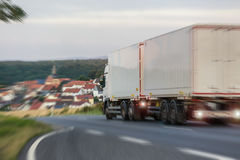 Truck speeding on a country road Stock Images