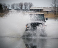 Truck splashing water Royalty Free Stock Photo
