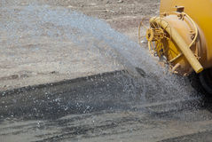 Truck spraying water Stock Image