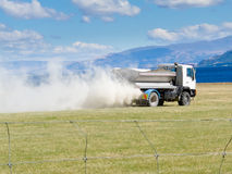 Truck spreading fertilizer on pasture meadow Royalty Free Stock Photography