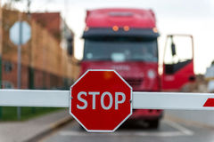Truck standing at the barrier with a STOP sign. Royalty Free Stock Photos