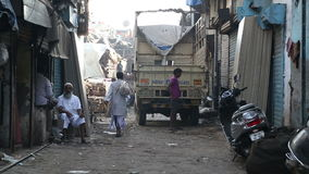 Truck standing in the street in Mumbai, with people passing by. MUMBAI, INDIA - 12 JANUARY 2015: Truck standing in the street in Mumbai, with people passing by stock footage