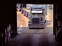 Truck in Steel Warehouse Door Royalty Free Stock Image