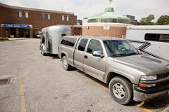 Truck and stock trailer at veterinary clinic Stock Photo