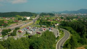 Truck stop and petrol station on highway, aerial view, A1 higway near Celje, Slovenia. Celje, Slovenia - July 6 2019: Aerial view of Lopata truck stop and petrol stock video