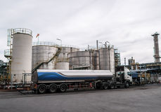 Truck and Storage tanks in oil refinery Royalty Free Stock Image
