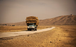 Truck with straw on the road Stock Photos