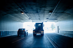Truck and SUV silhouettes inside tunnel Stock Photography