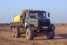 Truck terrain. Truck all terrain running in the steppe under different weather Royalty Free Stock Photos