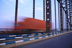 Truck throught the bridge Stock Photos
