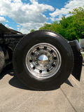 Truck tire with chrome wheel on a tractor truck. Closeup view of a truck tire and chrome wheel on a tractor trailer truck Royalty Free Stock Photo