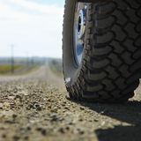 Truck Tire On Gravel Road. Stock Photography