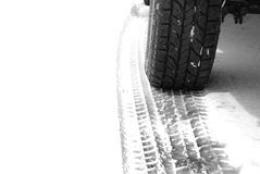 Truck Tire in Snow with Tread for Safety Royalty Free Stock Photo