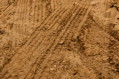 Truck Tire Tracks in Mud Stock Photo