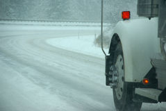 Truck tires spinning on highway during snowstorm stock image
