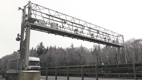 Truck toll system. Trucks pass a control gantry of german truck toll system on Autobahn A3 on January 20, 2015. Germany's LKW-Maut is a toll for goods vehicles stock footage