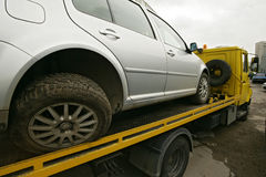 Truck tow. The damaged car on a platform for transportation. truck tow stock photo