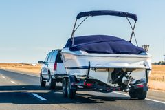 Truck towing a boat. On the interstate, California royalty free stock photo