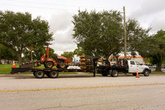 A truck towing a ditch witch in florida Stock Photo