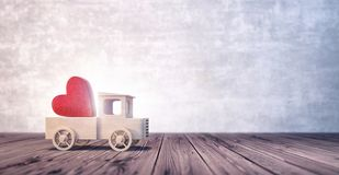 Truck toy arriving with shiny red heart royalty free stock image