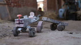 Truck toy on ground in house in Jodhpur, closeup. stock footage