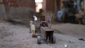 Truck toy on ground in house in Jodhpur, closeup. stock video footage