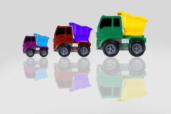 Truck toy mini, truck scale model made of plastic with multicolo. R isolated on grey background Stock Image
