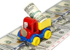 Truck toy on the road from money Royalty Free Stock Photo