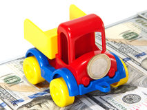 Truck toy on the road from money Royalty Free Stock Images