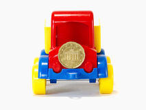 Truck toy on the road from money Stock Photo