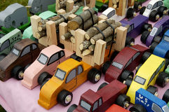Truck toys. A loads of logs being transported on toy trucksl Stock Photo