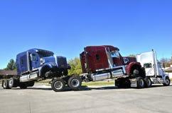 Truck tractors ride piggy back Stock Image