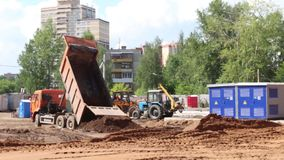 Truck and tractors work on construction site at summer day. Video with sound stock footage