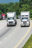 Truck Traffic On Interstate Highway Vertical With Copy Space Royalty Free Stock Photos