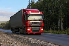 Truck with trailer goes on the highway Stock Photos