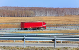 Truck with trailer goes on the highway Royalty Free Stock Image