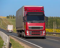 Truck with trailer goes on the highway Royalty Free Stock Photos