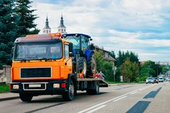 Truck trailer transporter with hauler carrying tractor on road Poland stock photos