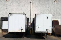 Warehouse Truck Trailers. Truck trailers in warehouse truck loading dock bays Stock Images