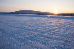 Truck trails in frozen lake Stock Photography