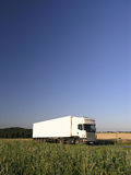 Truck transport. Ation fast speed over the fields Stock Photo