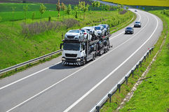Truck transport cars. Truck importing new cars, automotive business royalty free stock photos