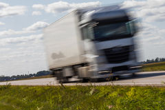 Truck transport on the road with motion blur. Blurred image back Stock Photos