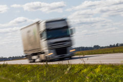 Truck transport on the road with motion blur. Blurred image back Royalty Free Stock Photography